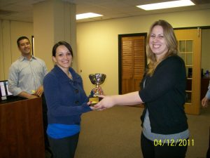 AHP Employee Denisse Bays receives her trophy