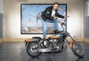 ING Direct president Arkadi Kuhlmann atop motorcycle