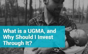 Text reads: What is a UGMA, and Why Should I Invest Through One? Image is of a man holding a baby.